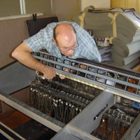 Pat Foster refurbishing the Raindirk mixing desk