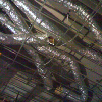 Airconditioning ducts above the ceiling grid